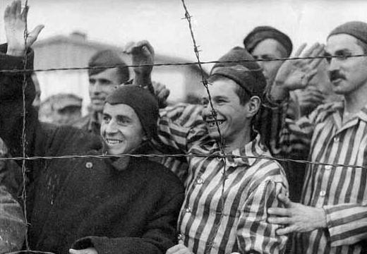 Dachau survivors greet liberators, April 29, 1945